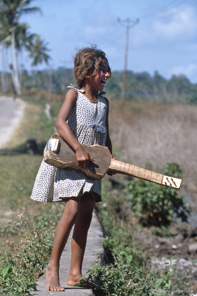 girl with the hand made guiter